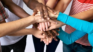 Hands together in a group circle